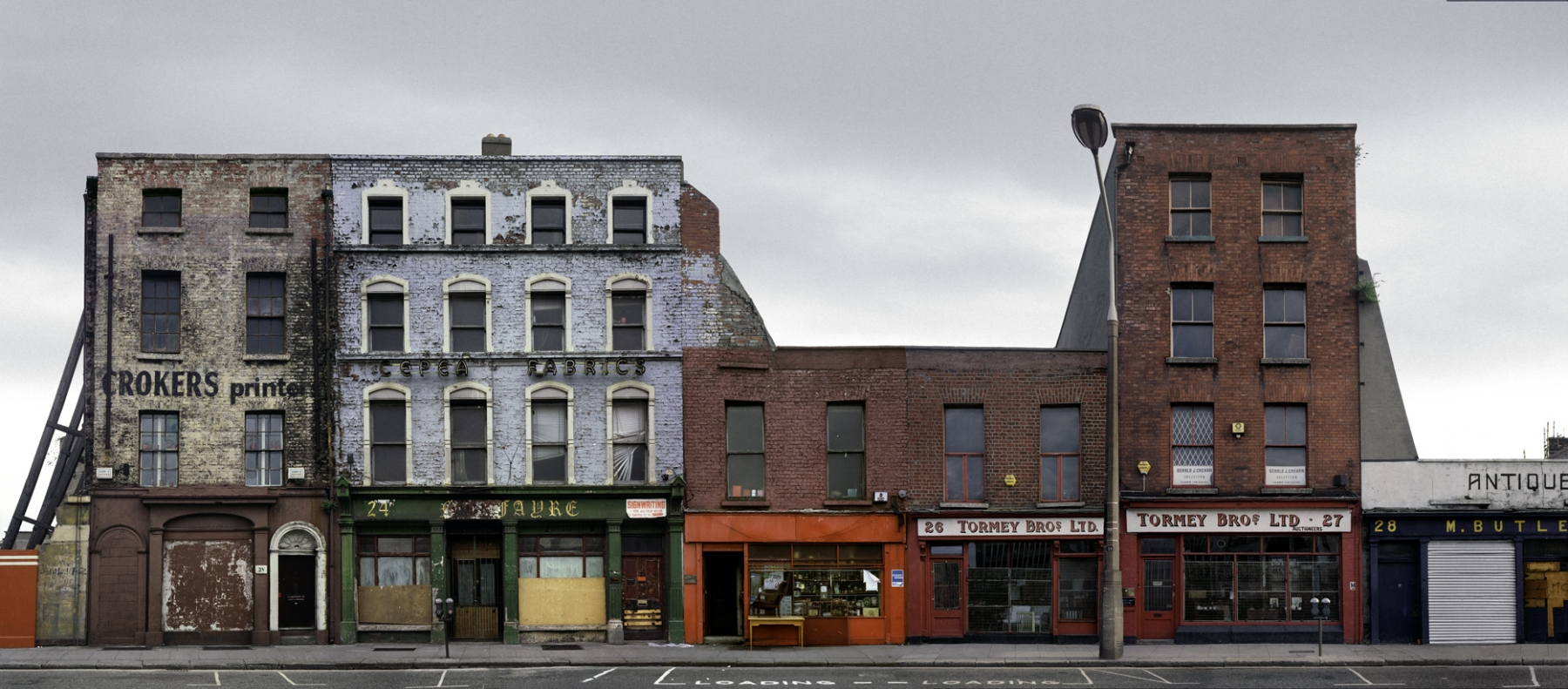 Auction House and Antique shops on Lower Ormond Quay, Dublin 1988 by David Jazay